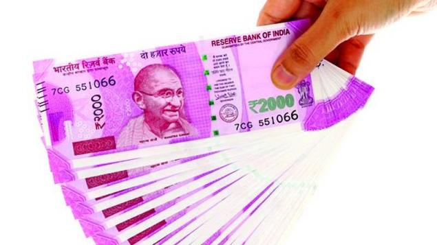 sbi report says rbi holding back 2000 notes